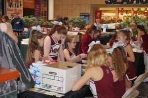 MMR Cheerleaders making Baby Bundle Bags for the Baby Bureau!